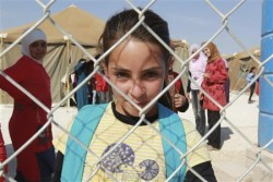 A Syrian refugee girl in Zaatari refugee camp in Jordan (Photo Credit: Reuters)