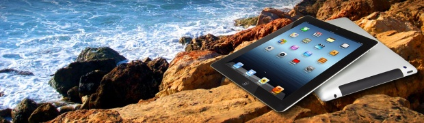tablet-laptop-on-sea-rocks-website-header