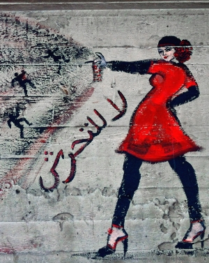 "FILE- This combination of two photos shows graffiti of a woman with the words ""no harassment,"" in Arabic, taken on June 23, 2012, left, and the addition by another artist, on Nov. 6, 2012 of a stick figure touching her backside, under a bridge in the upscale Zamalek neighborhood in Cairo, Egypt. Egyptian police on Monday, June 9, 2014 arrested seven men for sexually assaulting a 19-year-old student during celebrations marking the inauguration of the country's new president in Cairo's central Tahrir Square the day before, security officials said. (AP Photo/Maya Alleruzzo, File)"